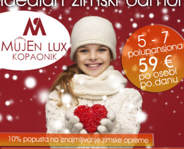 seasonal, people, happiness , health, charity, love concept - smiling teenage girl in winter clothes with small red heart